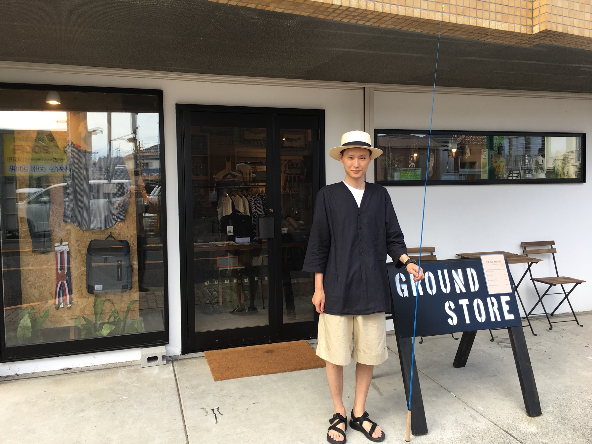 The owner out front of his shop