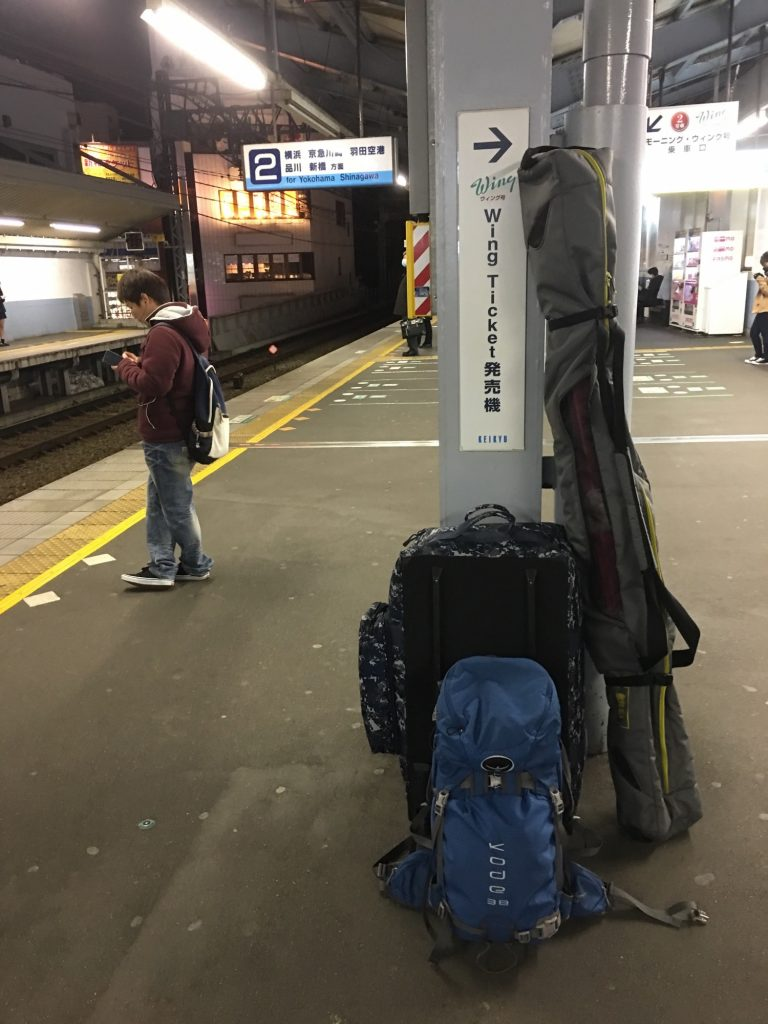 Ski gear stacked and waiting for the train