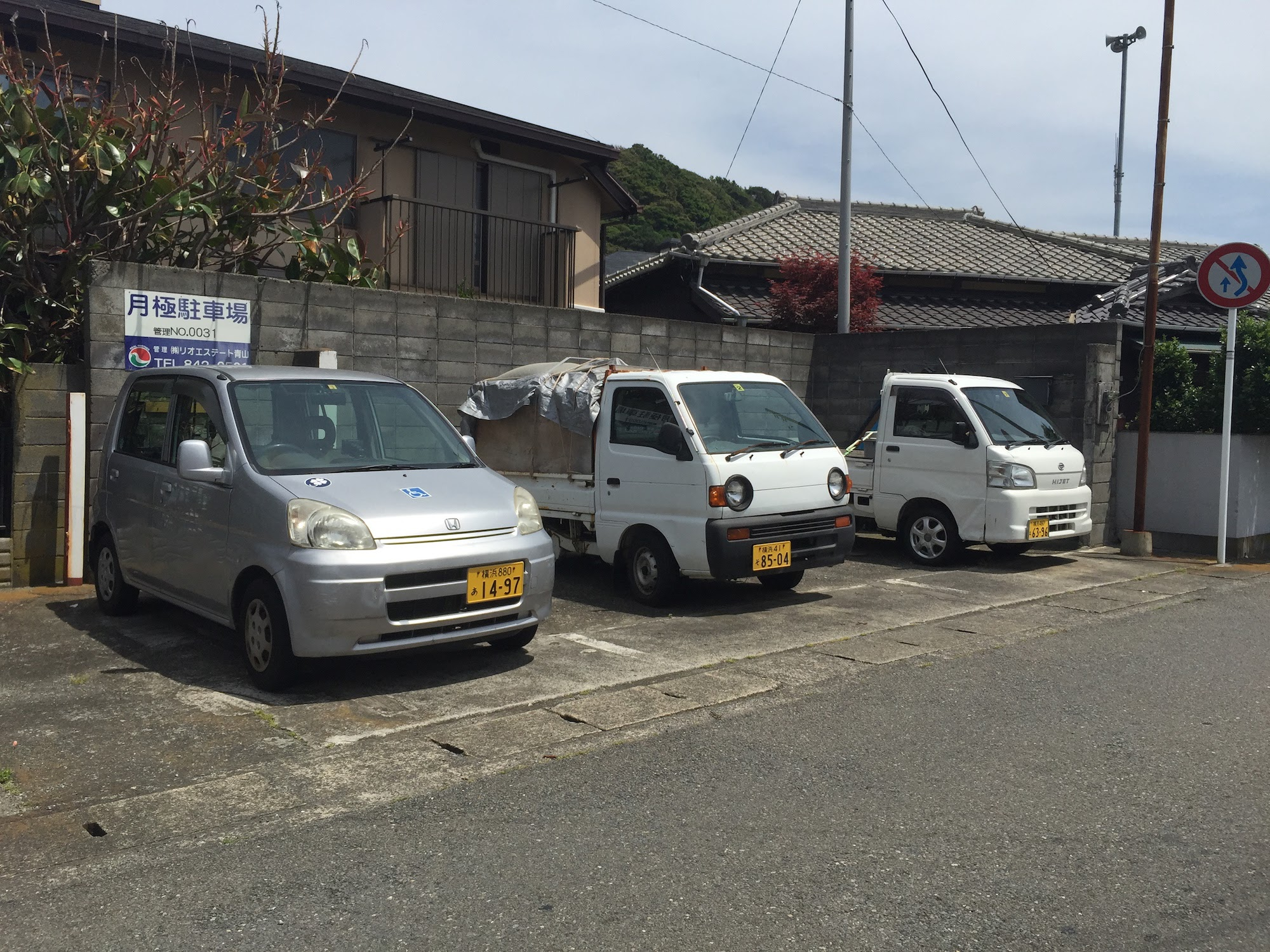 Parking lot filled with kei cars