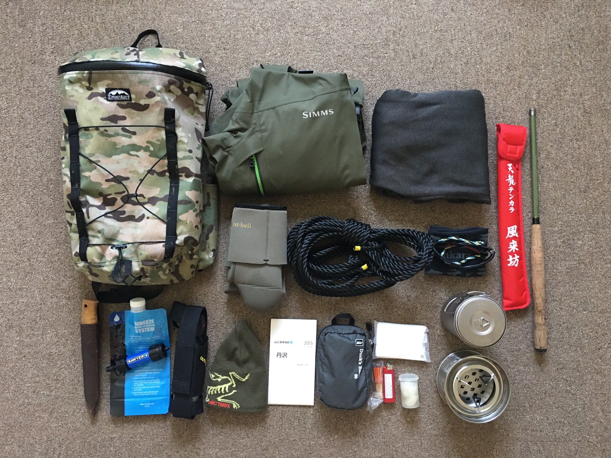 Gear laid out that fits inside the pack